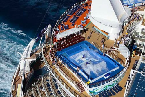 This ship, the Allure of the Seas, will share the title of the world's largest and most revolutionary cruise ship with sister-ship Oasis of the Seas. This architectural marvel spans 16 decks, encompasses 225,282 gross registered tons, weighs an estimated 100,000tons, and carries 5,400 guests at double occupancy. The Allure of the Seas will tout Royal Caribbean's exclusive neighborhood concept of seven distinct themed areas, which will include Central Park, Boardwalk, the Royal Promenade, the Pool and Sports Zone, Vitality at Sea Spa and Fitness Center, Entertainment Place and Youth Zone. The ship also features a two-deck dance hall, a theatre with 1,380 seats, and an ice skating rink.